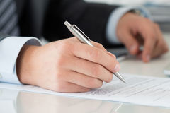 Close-up of businessman hands signing documents Royalty Free Stock Photography