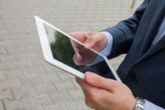 Close up of businessman hands with tablet pc. Copy space Royalty Free Stock Photography