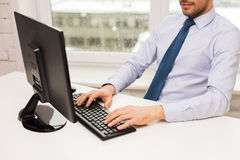 Close up of businessman hands typing on keyboard Royalty Free Stock Images