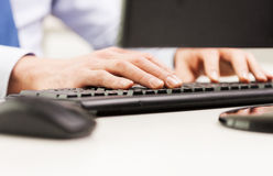Close up of businessman hands typing on keyboard Stock Photo