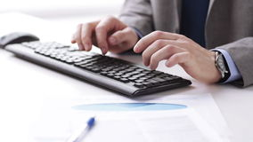 Close up of businessman hands typing on keyboard. People, business, technology and office work concept - close up of businessman hands typing on computer stock video