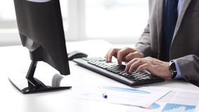 Close up of businessman hands typing on keyboard. People, business, technology and office work concept - close up of businessman hands typing on computer stock video footage