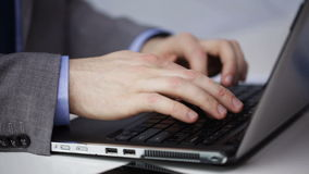 Close up of businessman hands typing on laptop stock video footage