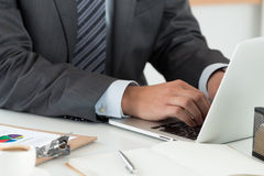 Close-up of businessman hands working on computer. Man writing something sitting at his office. Financial planning, reading news, online banking, distant Stock Photography