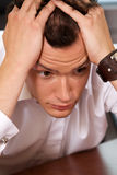 Close-up of businessman with head in hands Stock Photos