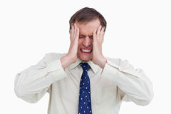 Close up of businessman with a headache Stock Images