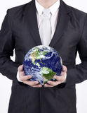 Close-up businessman hold globe - isolated. Businessman holding a globe isolated over white background. Confident asian businessman holding the planet earth Stock Photos