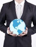 Close-up businessman hold world globe. Businessman holding a globe on white background Royalty Free Stock Photography