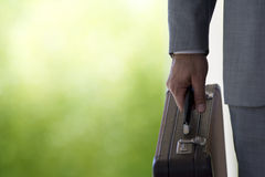 Close up of businessman holding briefcase Royalty Free Stock Image