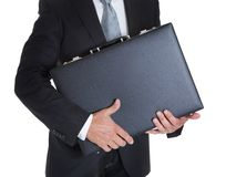 Close-up Of Businessman Holding Briefcase Stock Photo