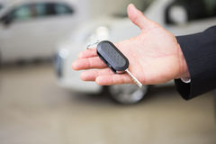 Close up of businessman holding car key Royalty Free Stock Photography