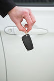Close up of businessman holding car key Royalty Free Stock Photo