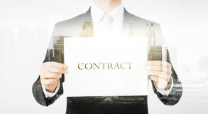 Close up of businessman holding contract paper Royalty Free Stock Image