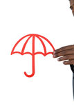 Close-up of businessman holding cut out umbrella Stock Image