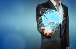 Close up of businessman holding digital globe on his palm Royalty Free Stock Photography