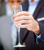 Close-up of a businessman holding a flute Stock Photo