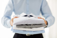 Close up of businessman holding folded shirts Royalty Free Stock Images