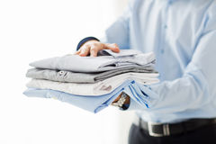 Close up of businessman holding folded shirts Royalty Free Stock Image