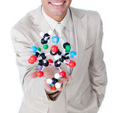 Close-up of a businessman holding a molecule Royalty Free Stock Photo