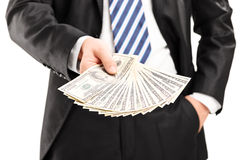 Close-up on a businessman holding money Stock Photography