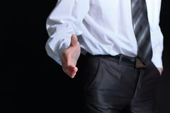 Close up.businessman holding out hand for a handshake royalty free stock photos