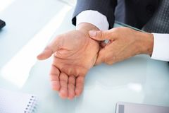 Businessman Holding Painful Wrist royalty free stock photos