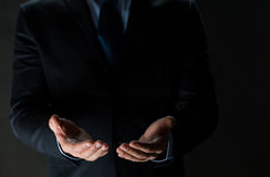 Close up of businessman holding something in hands Stock Image