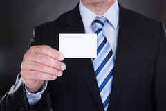 Close-up of businessman holding visiting card Stock Photos