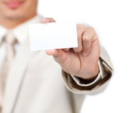 Close-up of a businessman holding a white card Stock Photo