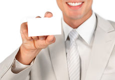 Close up of a businessman holding white card Royalty Free Stock Image
