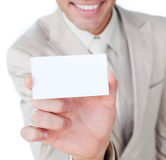 Close-up of a businessman holding a white card Royalty Free Stock Photography