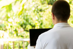 Close up of businessman with laptop outdoors Stock Photo