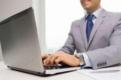 Close up of businessman with laptop and papers Stock Photography