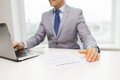 Close up of businessman with laptop and papers Stock Photos