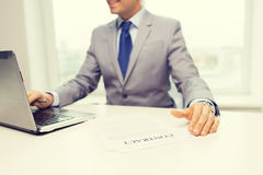 Close up of businessman with laptop and papers Stock Images