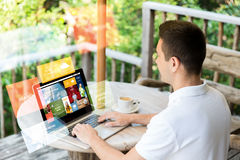 Close up of businessman with laptop on terrace Stock Image