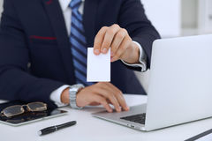 Close up of  businessman or lawyer  giving a business card while sitting at the table. He offering partnership and succe Royalty Free Stock Photo