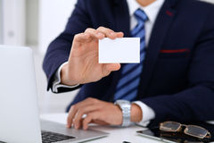 Close up of  businessman or lawyer  giving a business card while sitting at the table. He offering partnership and succe Royalty Free Stock Image