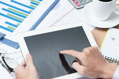Close-up of businessman looking at business document in touchpad Stock Photos