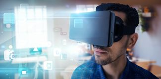 Composite image of close up of businessman looking though virtual reality simulator. Close up of businessman looking though virtual reality simulator against Stock Images