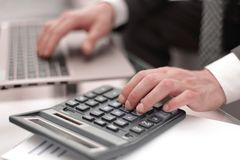 Close up.businessman makes calculations on the calculator. Accounting and technology royalty free stock photos