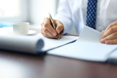 Close-up of Businessman makes a note Stock Photography