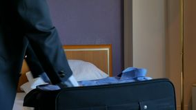 Closeup businessman or man packing suitcase stock footage