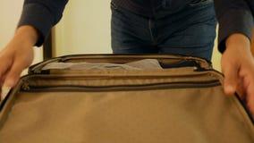 Closeup businessman or man packing suitcase. Close up businessman or man packing suitcase stock footage