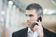 Close-up of businessman on mobile phone Royalty Free Stock Images