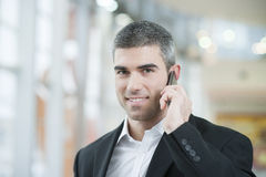 Close-up of businessman on mobile phone Royalty Free Stock Photo