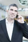Close-up of businessman on mobile phone Stock Photo