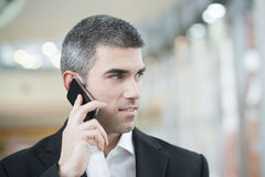 Close-up of businessman on mobile phone Royalty Free Stock Photography