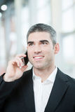 Close-up of businessman on mobile phone Stock Photos