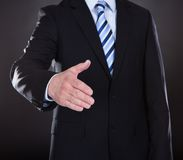 Close-up Of Businessman Offering Handshake Royalty Free Stock Photos